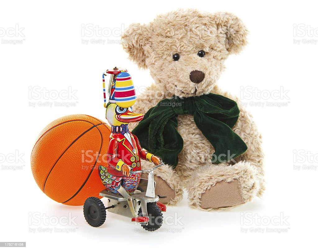 CuteTeddy Bear, Wind-up Tin Toy and Ball royalty-free stock photo