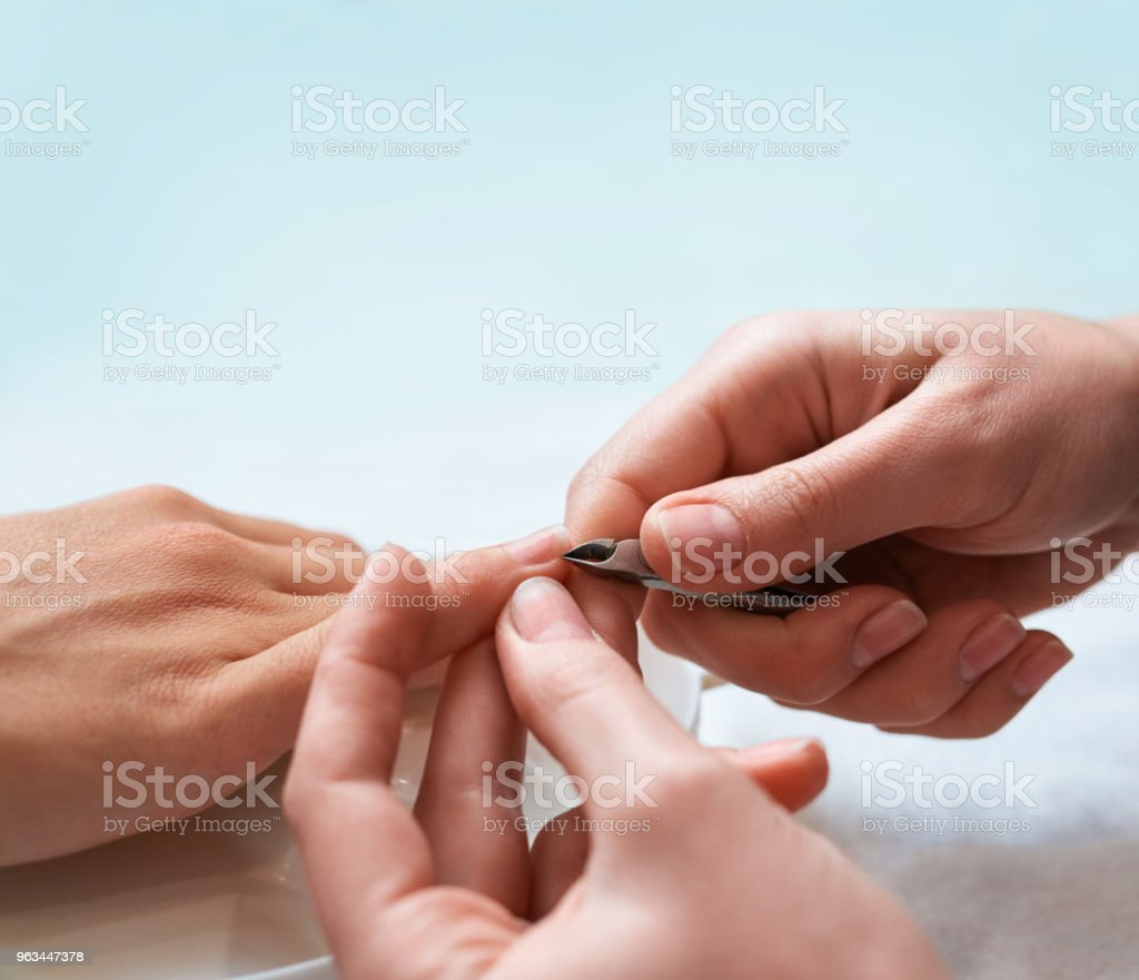 cuticle cutting procedure, Hand with pliers close up. - Zbiór zdjęć royalty-free (Biznes)