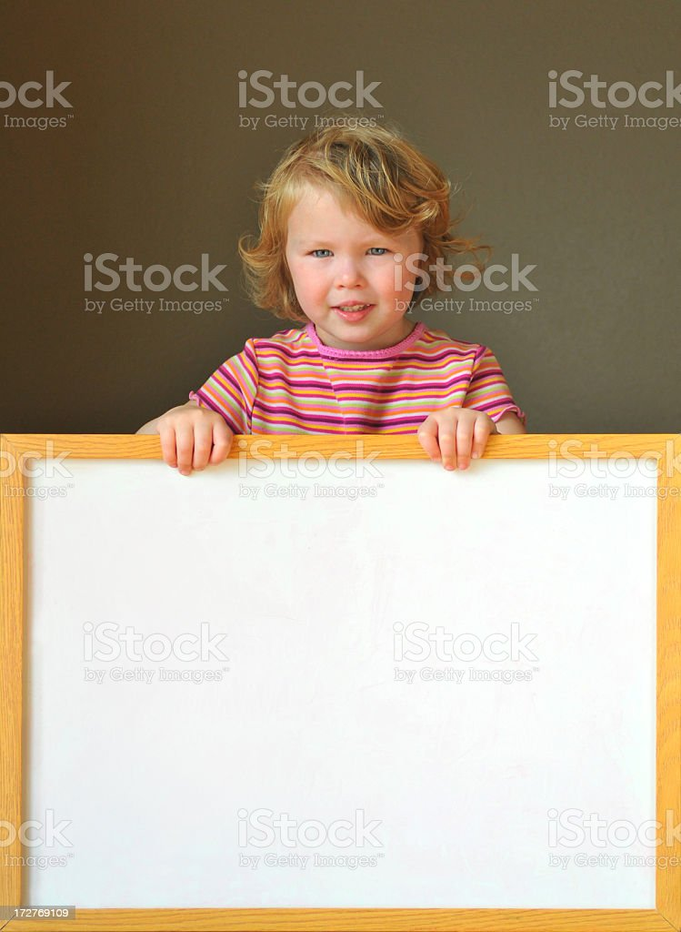 cutie holding a sign royalty-free stock photo