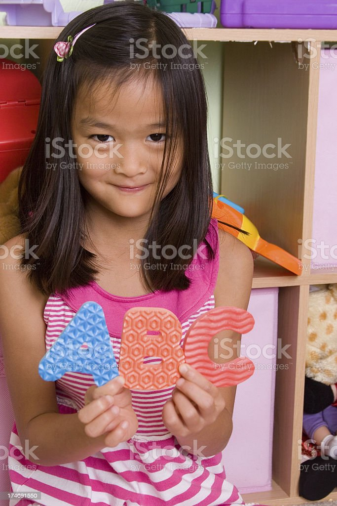 Cutie holding up ABC letters royalty-free stock photo