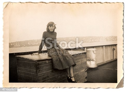 An old family photo of a woman riding a ferry.