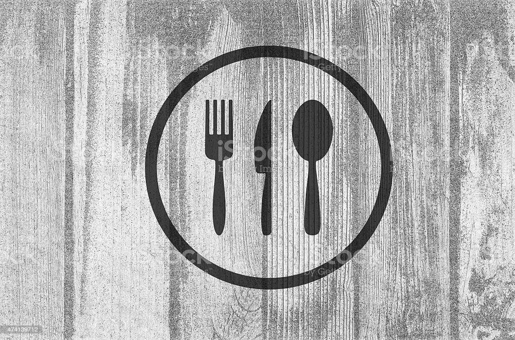 Cutlery icons on planked wood background stock photo