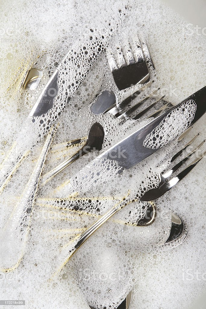 Cutlery in soap sud royalty-free stock photo