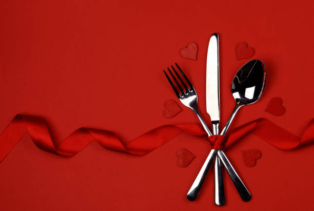 Cutlery set and hearts stock photo