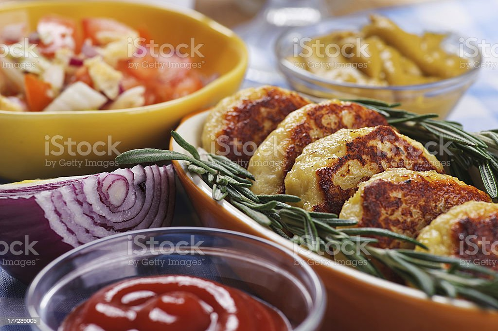 Cutlets with fresh rosemary royalty-free stock photo