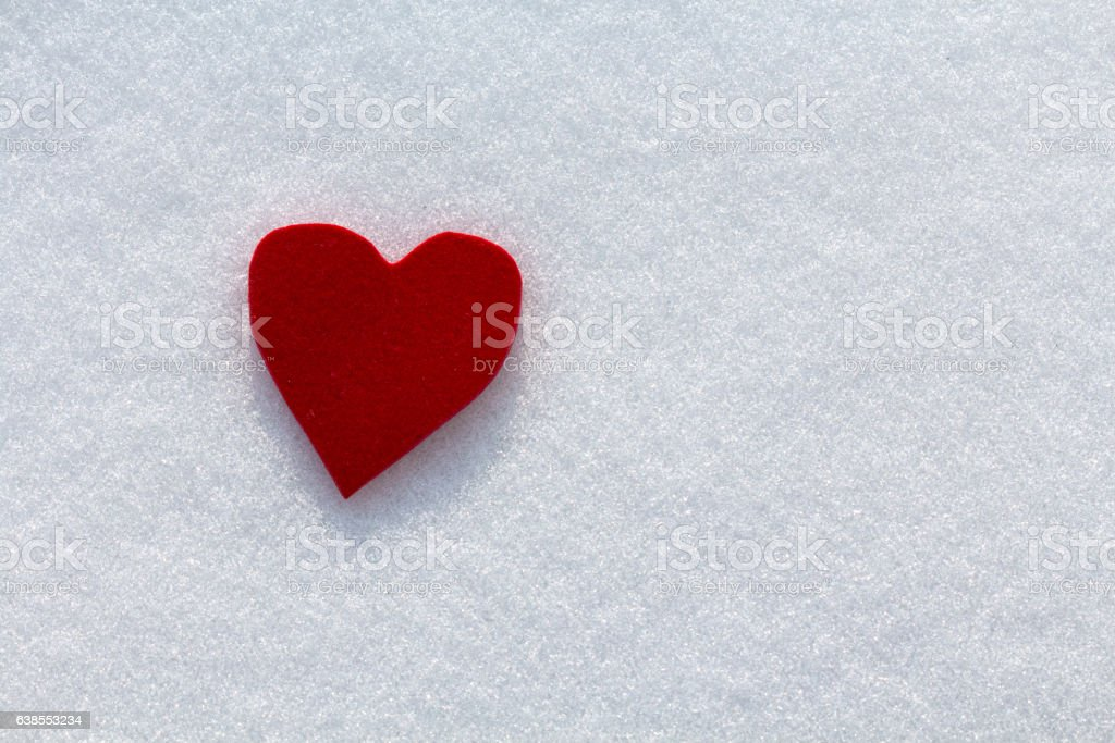 Cutout red heart in the snow stock photo