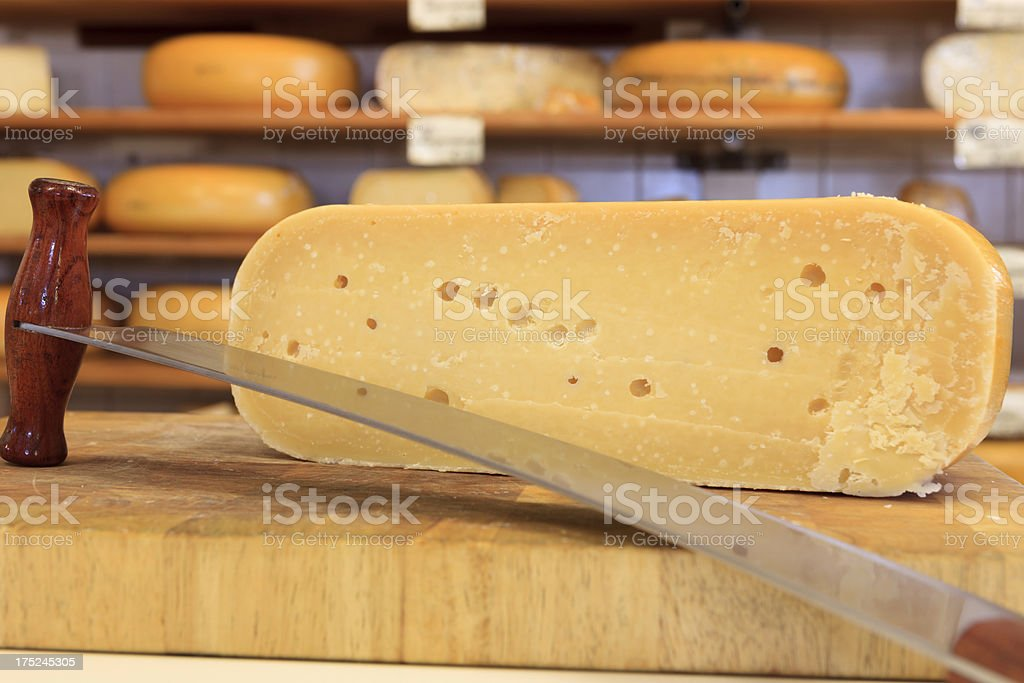 cutted cheese on a wooden cutting board stock photo