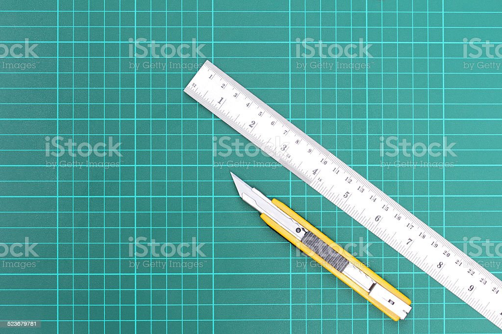 Cutter and metal ruler stock photo