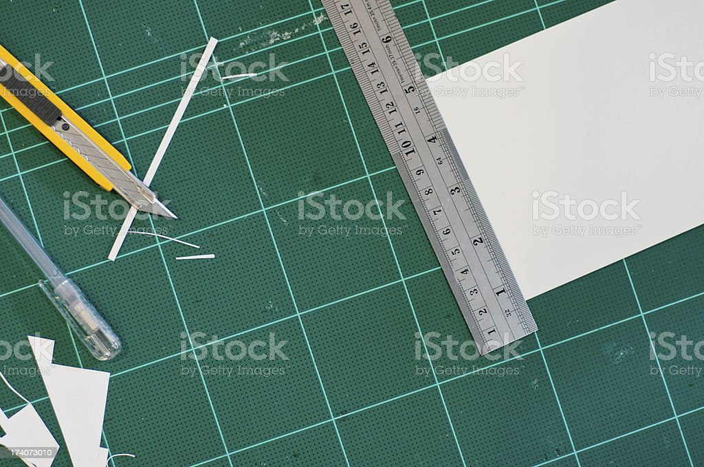 Cutter and Ruler on a Cutting Mat stock photo
