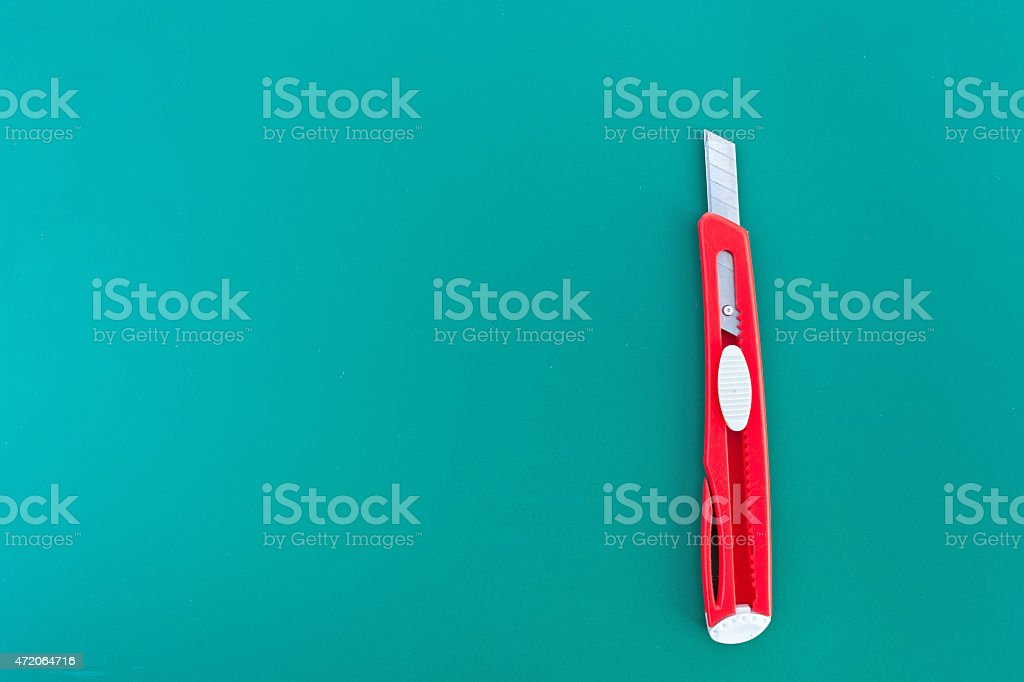 cutter on green cutting mat isolate for text stock photo