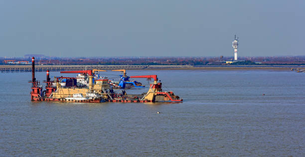 Cutter suction dredgers at work stock photo