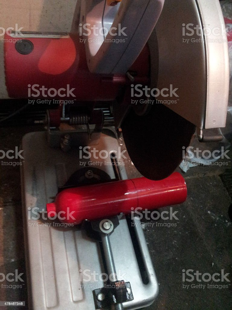 Cutting a fire extinguisher in half stock photo