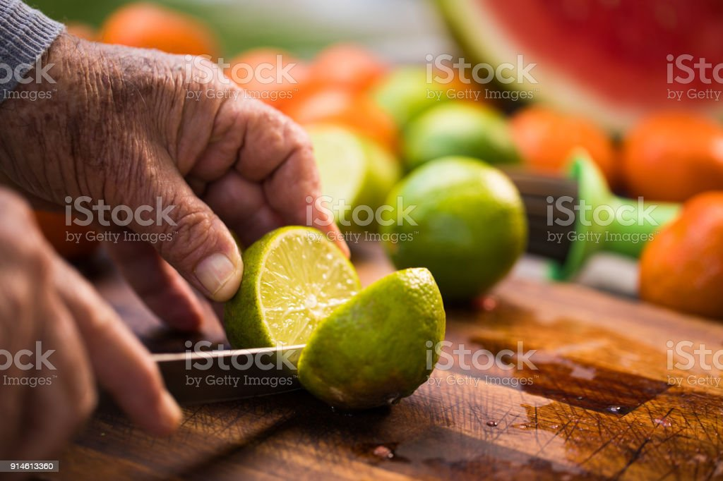 Cutting a lime stock photo