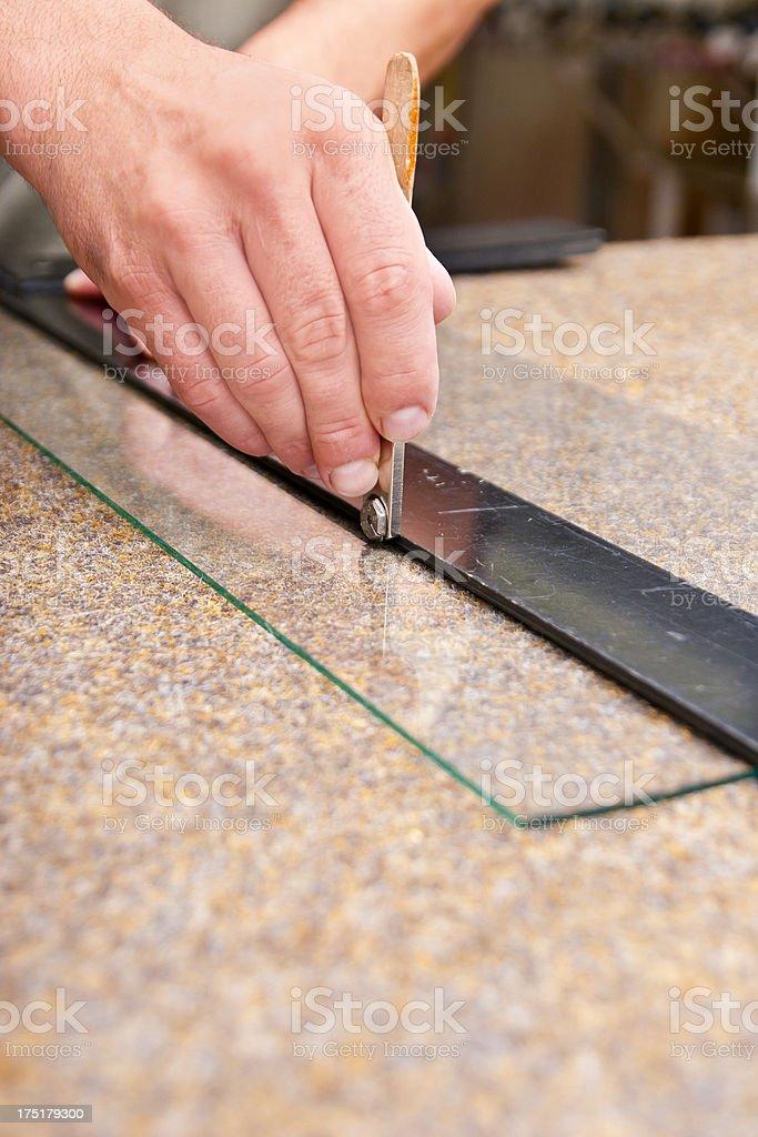 Cutting a sheet of glass stock photo