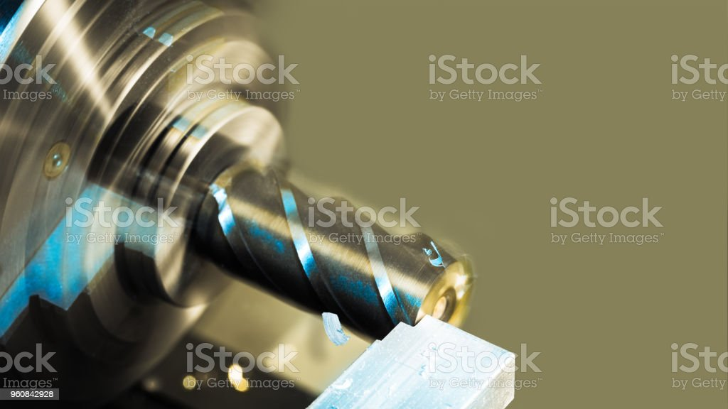 Cutting an aluminum workpiece by end mill. Industrial background. Beautiful motion blur stock photo
