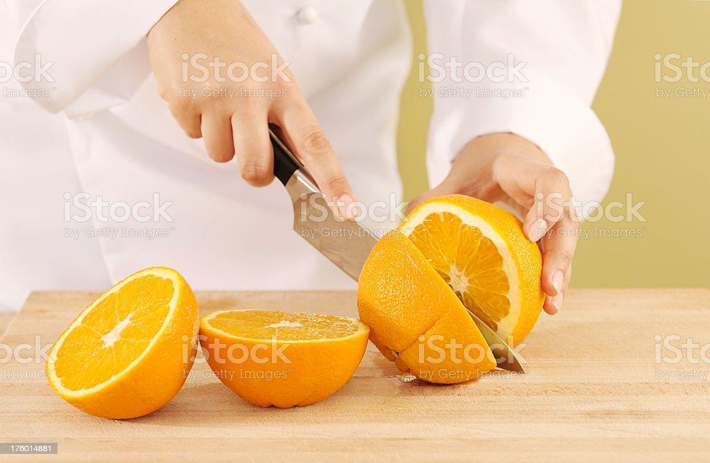 Cutting an Orange stock photo