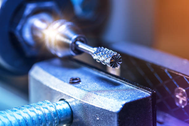 Cutting and milling machine or lathe Creative abstract heavy industry, metal processing and steel manufacturing industrial business concept: macro view of the tip of rotary blade of CNC cutting machine with selective focus effect socket wrench stock pictures, royalty-free photos & images