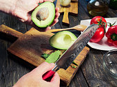 Cutting and peeling avocado for salad