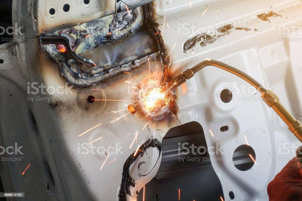 Carrosserie coupe avec la torche de gaz photo libre de droits