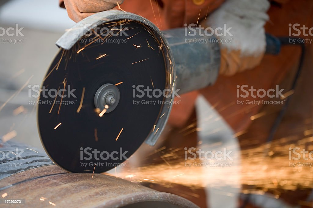 cutting big pipe with grinder: sparks royalty-free stock photo