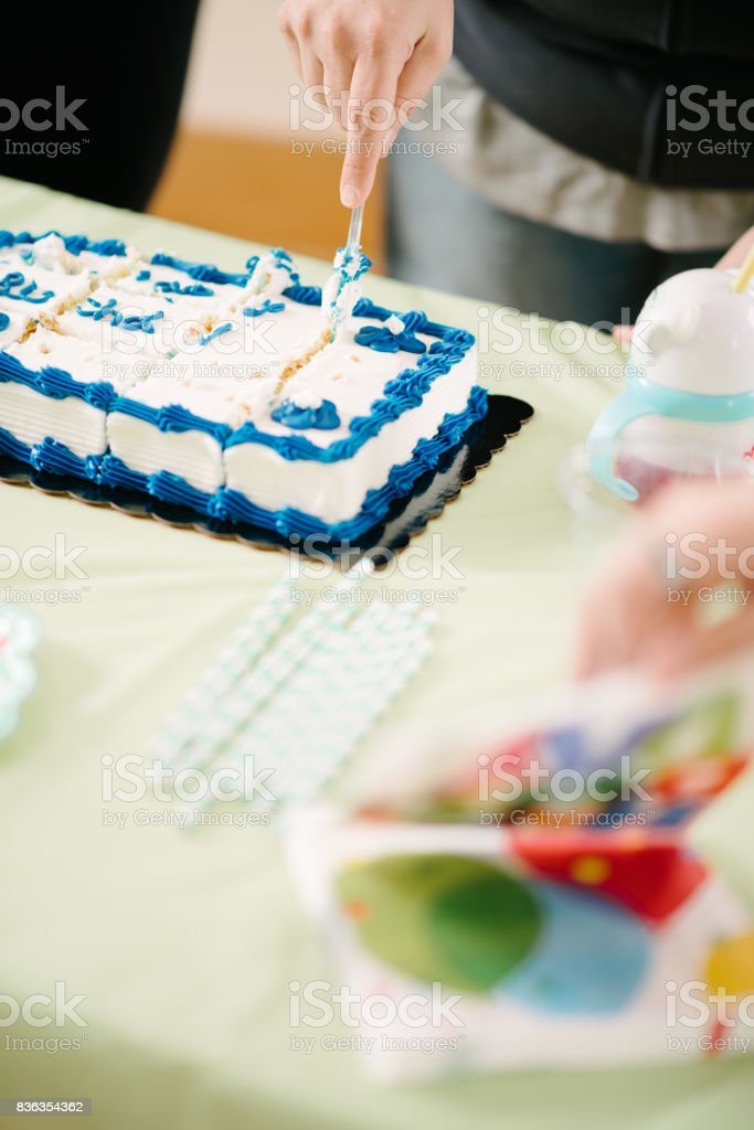 Cutting birthday cake stock photo