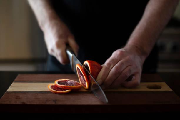 Cutting blood orange stock photo