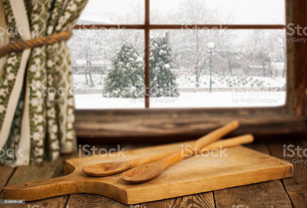 Cutting board  and spoon on vintage windowsill stock photo