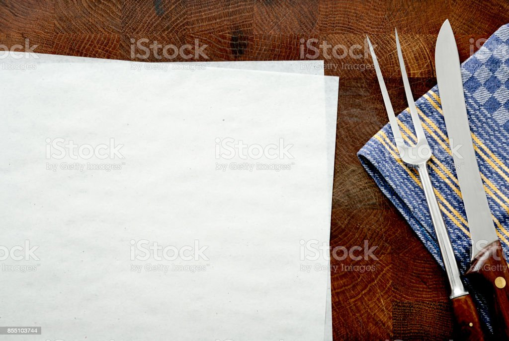 Cutting board, fork, knife, cloth, paper stock photo