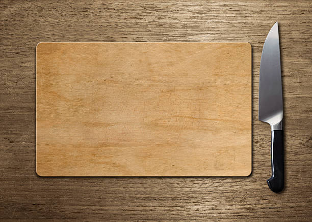 cutting board on wood table stock photo