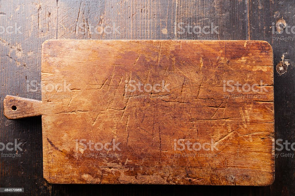 Cutting board on wooden background stock photo