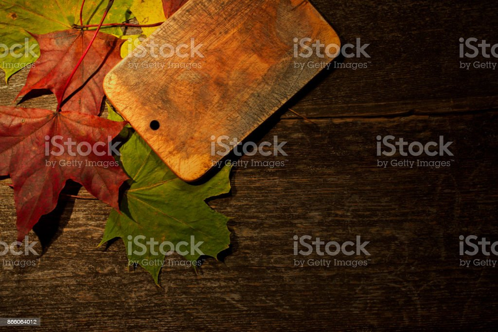 Cutting board on wooden kitchen table stock photo