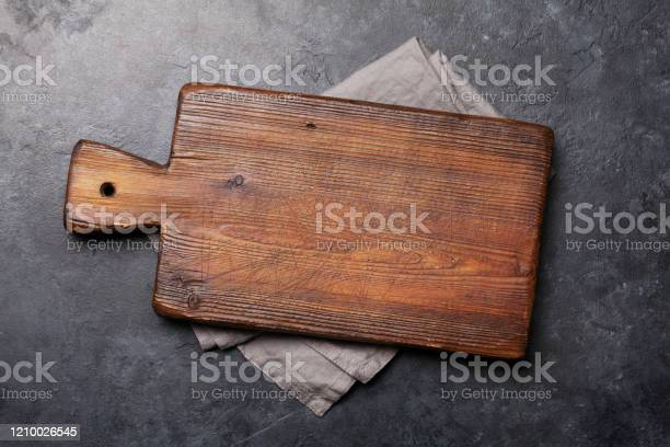 Cutting Board Over Towel On Stone Kitchen Table Stock Photo Download Image Now Istock
