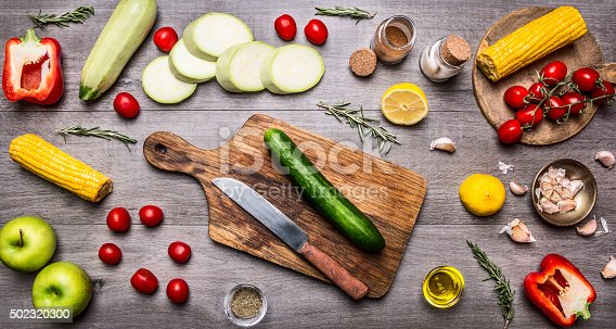 istock cutting board,Healthy foods, cooking and vegetarian concept. 502320300