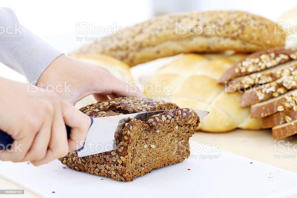 Cutting bread. stock photo