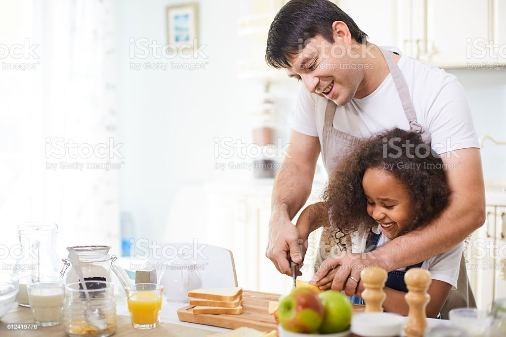 Cutting bread stock photo