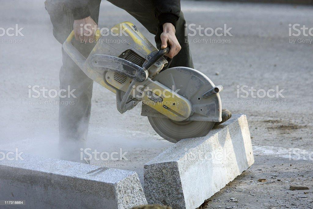Cutting brick stock photo