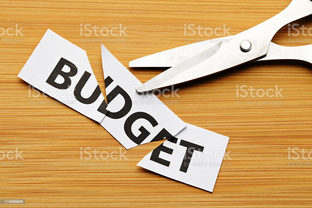 cutting budget with scissor stock photo