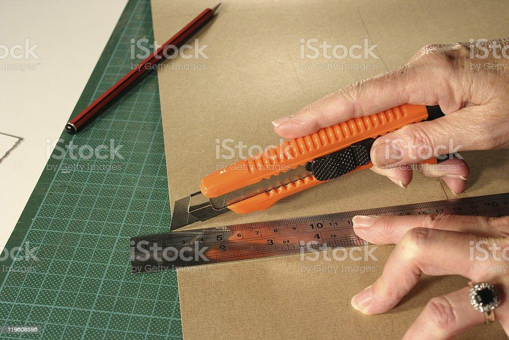 Cutting Cardboard Craft with Blade stock photo