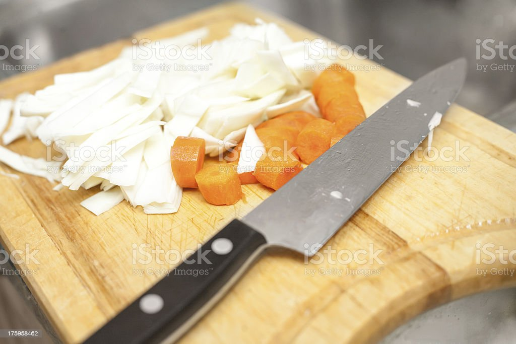 cutting carrot royalty-free stock photo
