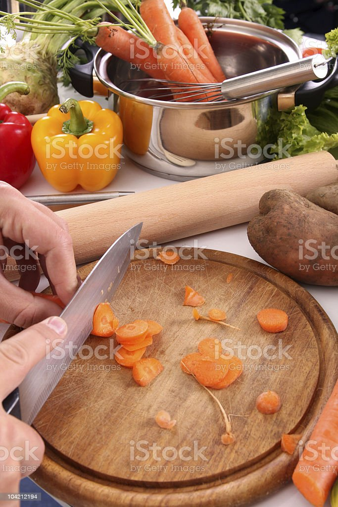 cutting carrots royalty-free stock photo