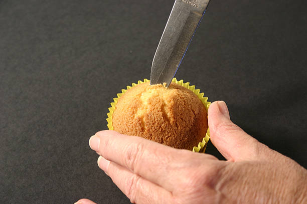 Cutting Centre from Cupcake with Knife stock photo