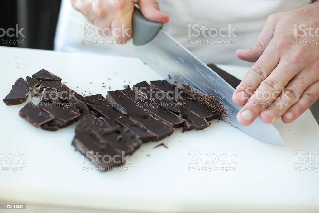 Cutting chocolate royalty-free stock photo