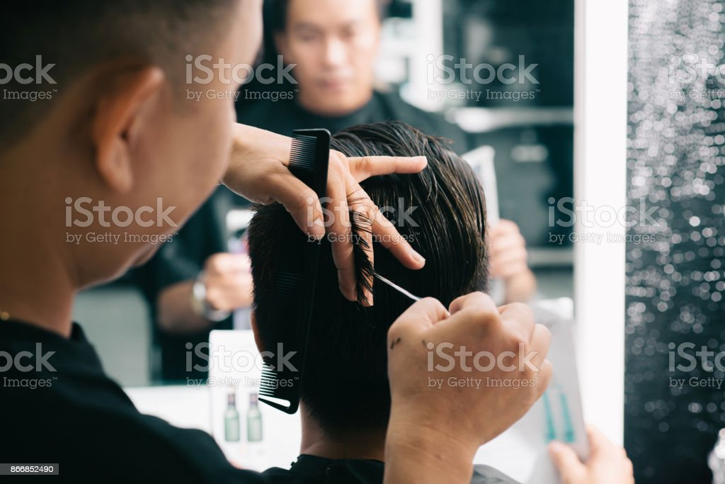 Cutting clients hair stock photo