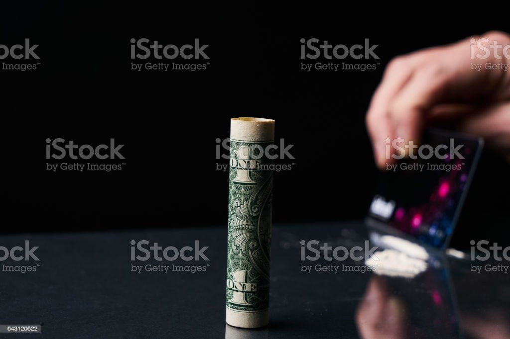 Cutting Cocaine with Credit Card Illegal Drug stock photo