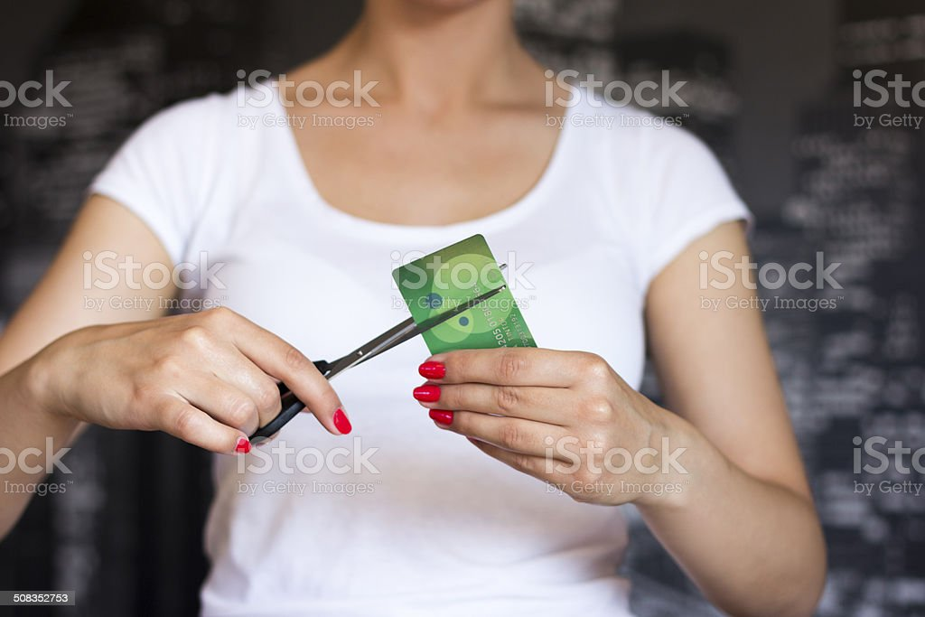 Cutting credit card. stock photo