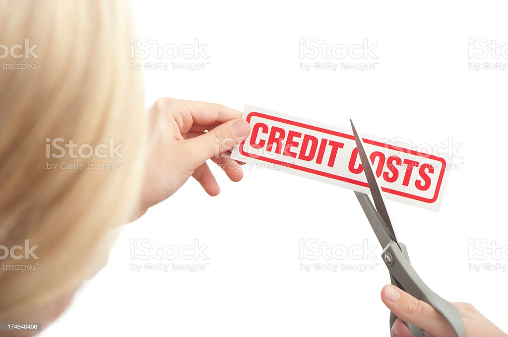 Cutting credit costs royalty-free stock photo