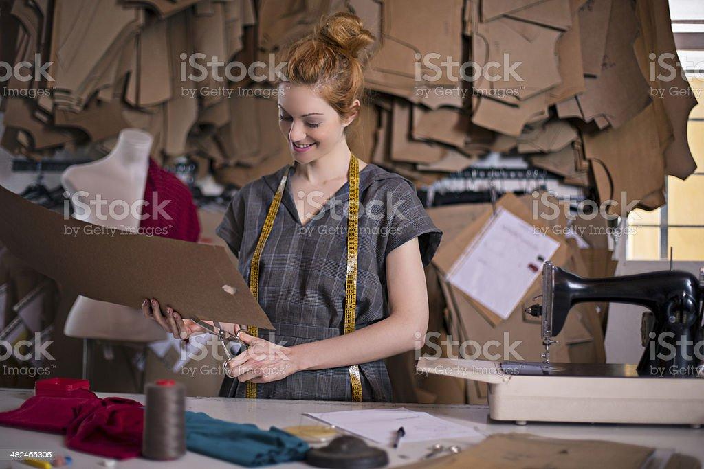 Cutting dressmaker patterns stock photo