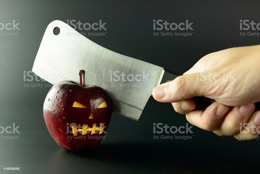 Cutting evil apple stock photo