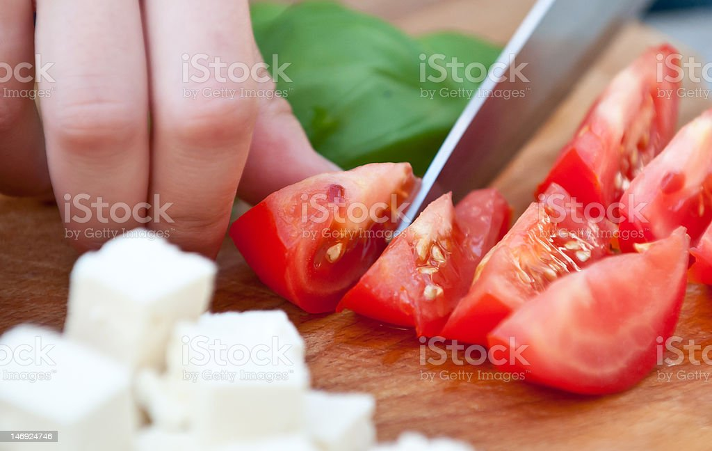 Cutting fresh tomatoes royalty-free stock photo