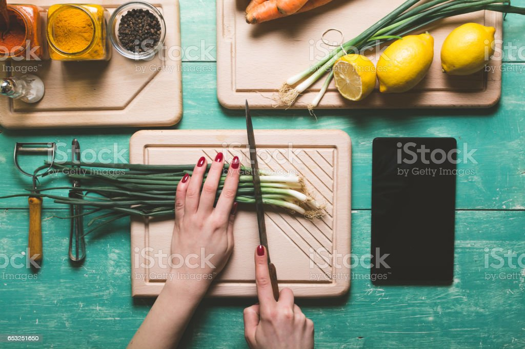Cutting fresh vegetables stock photo